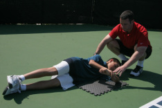 Mark Kovacs stretching student